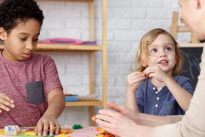 Preschool kids on kindergarten activities with their teacher
